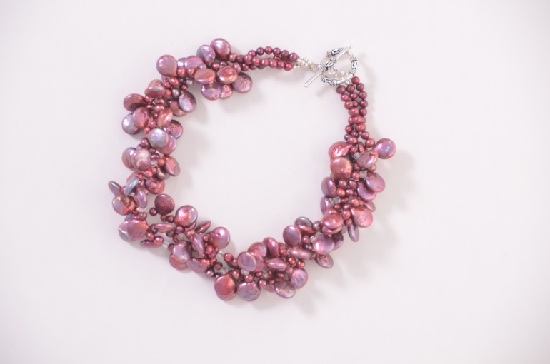 http://everyday-jewels.com/shop/fuchsia-freshwater-pearls-crystal-three-strand-twist/